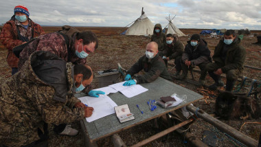 Locals take part in early voting in the 2021 Russian legislative election at a reindeer breeders' camping ground near the village of Karataika in Nenets Autonomous Area in far northern Russia