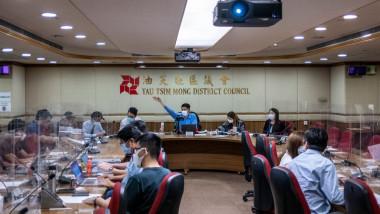 District Council Members of the Yau Tsim District Council during a meeting of the District Council in Hong Kong