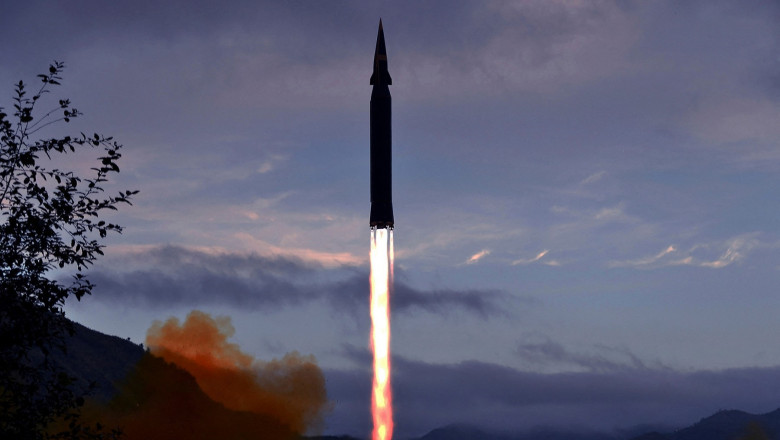 This picture taken on September 28, 2021 and released from North Korea's official Korean Central News Agency (KCNA) on September 29 shows the Academy of Defence Science of the DPRK test-firing a hypersonic missile Hwasong-8 newly developed by it in Toyang-ri, Ryongrim County of Jagang Province, North Korea