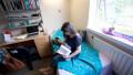 Female university student in her room University Hall of Residence Reading UK