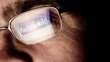 Facebook social networking site logo reflected in glasses