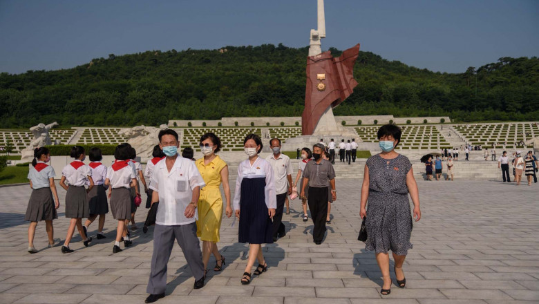 People pay their respects at the Fatherland Liberation War Martyrs Cemetery as part of events marking the occasion of the 68th anniversary of the end of the Korean War