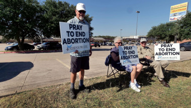"""Planned Parenthood clinis in the shopping center along I-35E in Denton, Texas is picketed by """"40 Days for Life"""" prayer vigil. Texas residentents started protesting on September 16th and will picket till the end of October. Forty days. Anti-abortion activi"""