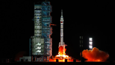 The crewed spaceship Shenzhou-13, atop a Long March-2F carrier rocket, is launched from the Jiuquan Satellite Launch Center in northwest China's Gobi Desert