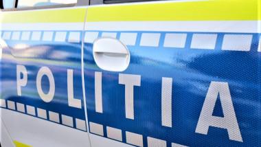masina de politie detaliu de pe partea laterala