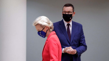 Euopean Commission President Ursula von der Leyen (L) and Poland's Prime Minister Mateusz Morawiecki (R) arrive for an EU summit at the European Council building in Brussels