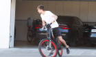 *EXCLUSIVE* Spanish Footballer Gerard Pique riding a bicycle in Barcelona