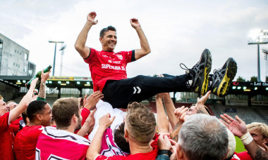 Vejle, Denmark. 14th July, 2020. Vejle Boldklub win promotion to the Danish 3F Superliga after a 1-0 win against Nykobing FC in the NordicBet Liga at Vejle Stadion in Vejle. Here the players pay tribute to manager Constantin Galca. (Photo Credit: Gonzales