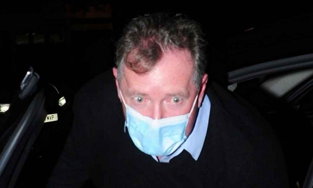 *EXCLUSIVE* Good Morning Britain's outspoken presenter Piers Morgan dons his face mask as he arrived for a family meal at the Ivy Chelsea Garden in London.