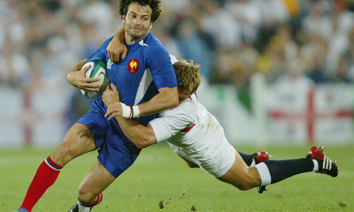 Christophe Dominici of France is tackled by Jonny Wilkinson