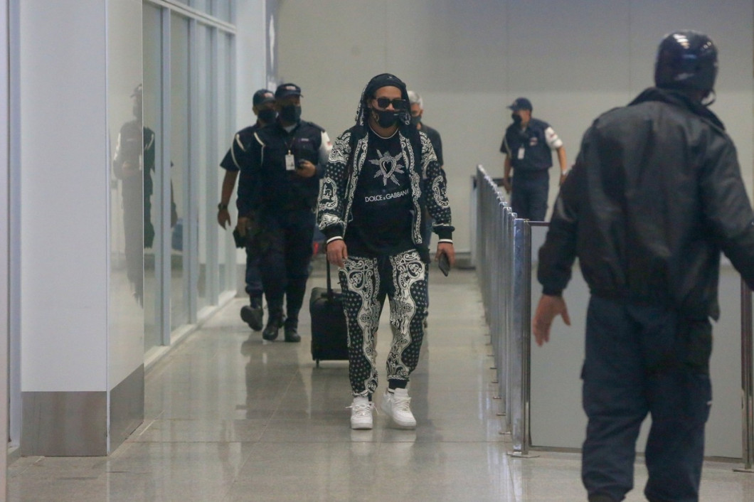 Ronaldinho Gaucho is greeted by fans and media as he arrives in Rio de Janeiro