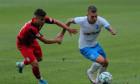 Alex Cicâldău, în duel cu George Merloi într-un meci Universitatea Craiova - Astra Giurgiu / Foto: Sport Pictures