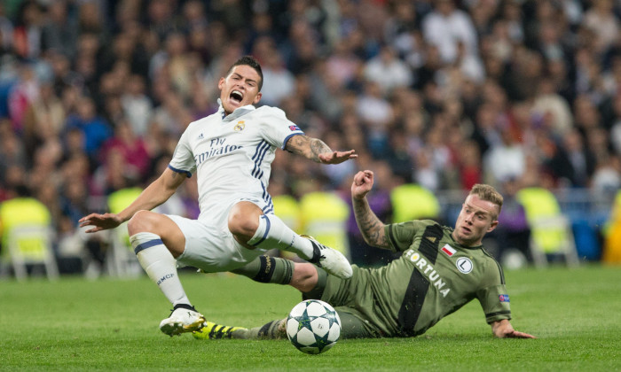 Madrid, Spain. 18th October, 2016. Real Madrid's Colombian midfielder James Rodriguez and Thibault Moulin of Legia Warszawa during the UEFA Champions League match between Real Madrid and Legia Warszawa at the Santiago Bernabeu Stadium in Madrid, Tuesday,
