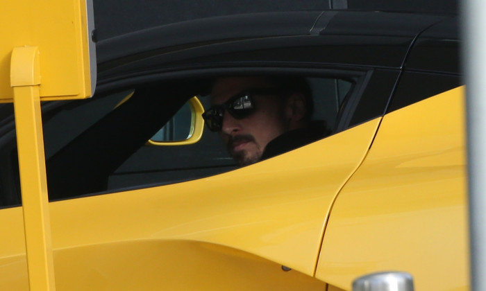 Milan AC soccer player Zlatan Ibrahimovic drives his limited production hybrid sport car Ferrari