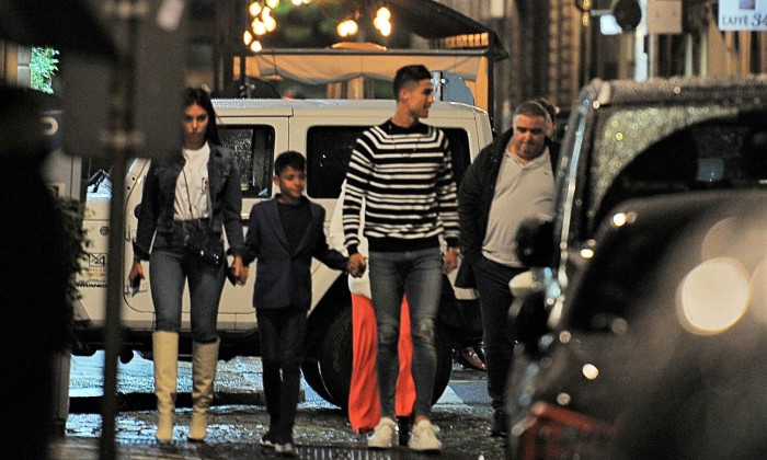 *EXCLUSIVE* Cristiano Ronaldo and his family surrounded by his security entourage leaving a restaurant in Turin