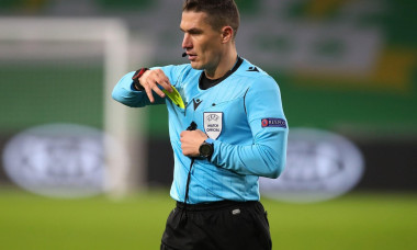 Referee Istvan Kovacs shows Sparta Prague's David Pavelka (centre) a yellow card for unsporting behaviour during the UEFA Europa League Group H match at Celtic Park, Celtic.