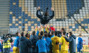 Ploiesti, Romania. 17th Nov, 2020. The romanian staff and the team players throwing Adrian Mutu the head coach of Romania in the air of joy during the European Under-21 Championship 2021 Qualifying Round match between the national teams of Romania and Den