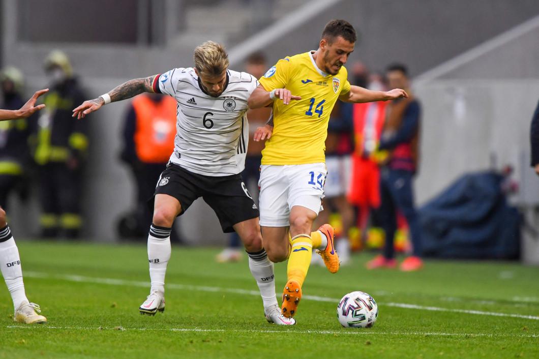 Răzvan Oaidă și Niklas Dorsch, în meciul România U21 - Germania U21 / Foto: Profimedia