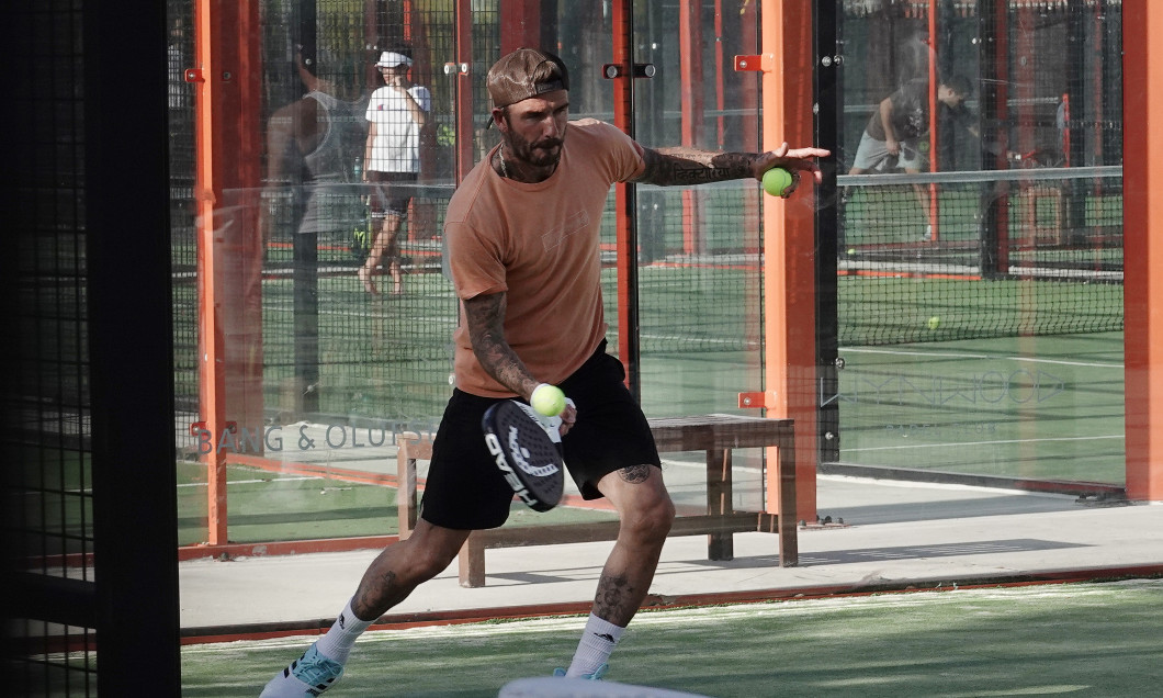 EXCLUSIVE: David Beckham looks intensely focused as he tries out a new sport, paddle ball, with friends in Miami