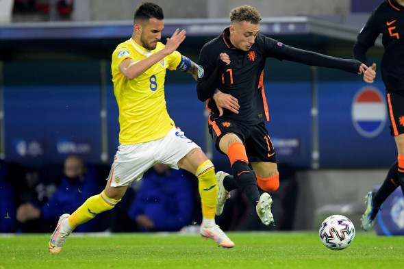 BOEDAPEST, HUNGARY - MARCH 24: Marius Marin of Romania U21, Noa Lang of The Netherlands U21 during the UEFA Under 21 Euro Championship Group Stage mat