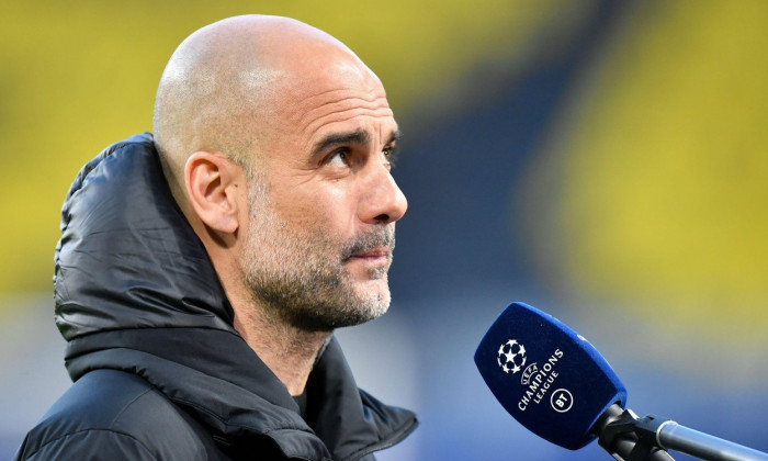 "Dortmund, Germany. 14th Apr, 2021. Football: Champions League, knockout round, quarter-finals, second leg, Borussia Dortmund - Manchester City at Signal Iduna Park. Coach Josep ""Pep"" Guardiola of Manchester gives an interview before the match. Credit: Mar"
