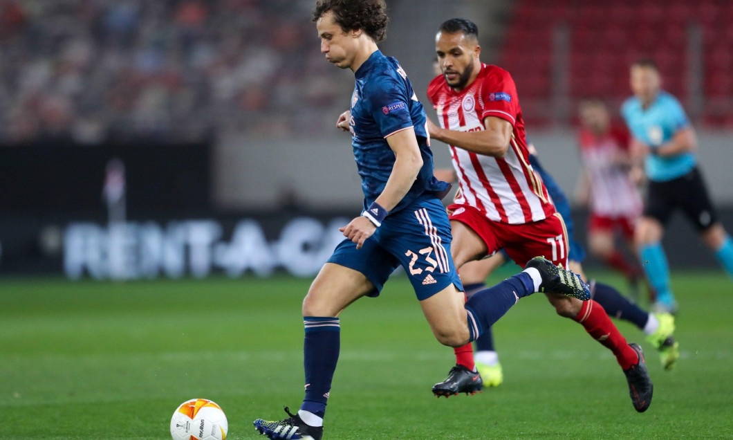 PIRAEUS, GREECE - MARCH 12: David Luiz of Arsenal FC and Youssef El Arabi of Olympiacos FC during the Olympiacos v Arsenal - UEFA Europa League Round
