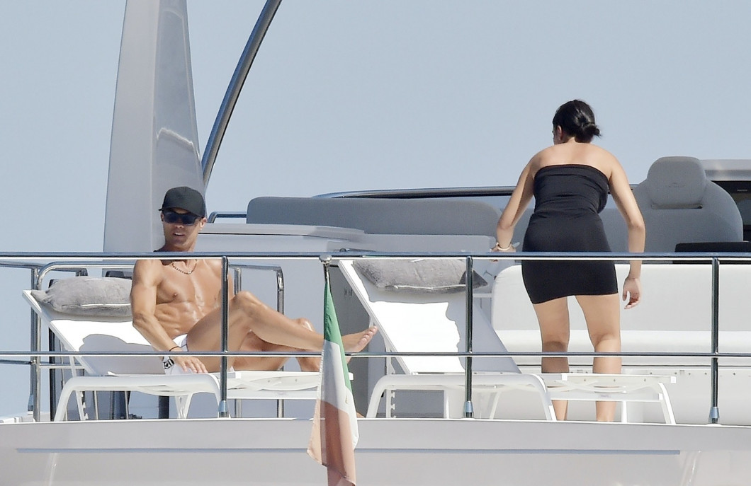 *EXCLUSIVE* Juventus FC footballer Cristiano Ronaldo and his partner Georgina Rodriguez pictured relaxing with friends on a yacht in Portofino.