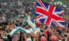 Silverstone, UK. 14th July 2019. FIA F1 Grand Prix of Britain, Race Day; Mercedes AMG Petronas Motorsport driver Lewis Hamilton celebrates his win with the fans Credit: Action Plus Sports Images/Alamy Live News