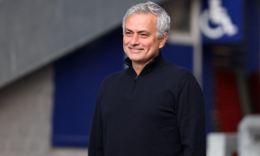 Tottenham Hotspur manager Jose Mourinho smiles as he chats with a Everton safety steward before the Premier League match at Goodison Park, Liverpool. Picture date: Friday April 16, 2021.