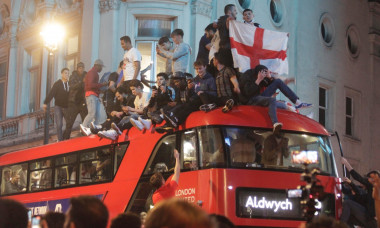 England Fans pictured in Piccadilly and Haymarket jumping on the famous red double-decker bus celebrating after their team reached the Euro's 2020 final beating Denmark 2-1 at Wembley stadium.