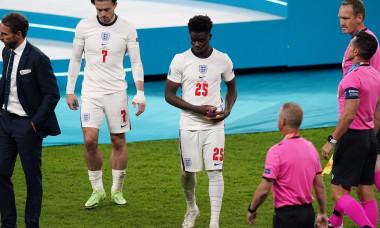 England's Bukayo Saka (25) alongside manager Gareth Southgate following the UEFA Euro 2020 Final at Wembley Stadium, London. Picture date: Sunday July 11, 2021.