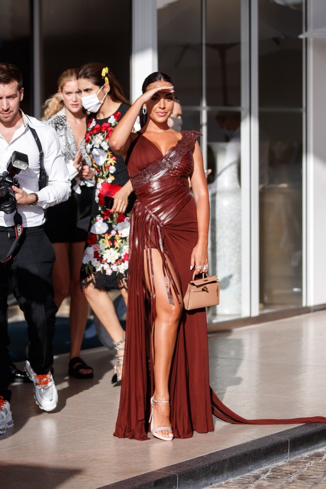 Georgina Rodriguez spotted at the Martinez Hotel in a long burgundy dress during the 74th Cannes Film Festival.