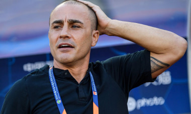 Italian former professional footballer and current manager of Chinese club Guangzhou Evergrande Fabio Cannavaro reacts during the first-round match after Chinese Football Association Super League (CSL) reopens against Shanghai Greenland Shenhua in Dalian
