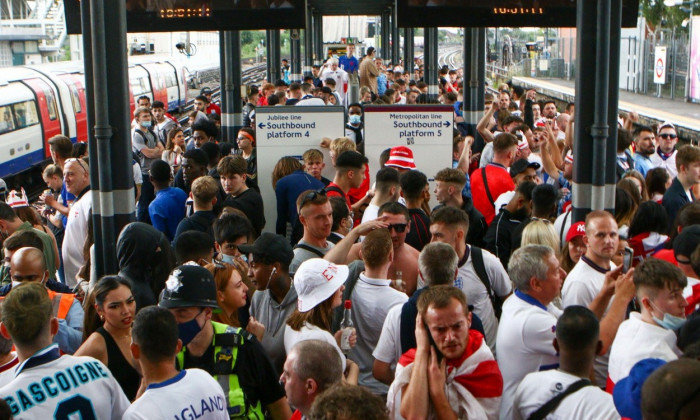 Wembley, London, UK. 12th July, 2021. The Wembley Park station is packed with people as they wait for the train to travel towards central London. 11/07/2021, Marcin Riehs/Pathos Credit: One Up Top Editorial Images/Alamy Live News