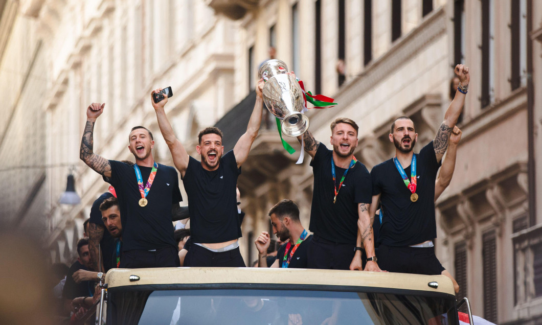 ROME, ITALY - JULY 12, 2021. Federico Bernardeschi, Alessandro Florenzi, Ciro Immobile and Leonardo Bonucci of the Italian national team celebrate the victory at Euro 2020 by exhibiting the European Cup from an open bus with a tour in the center of Rome.