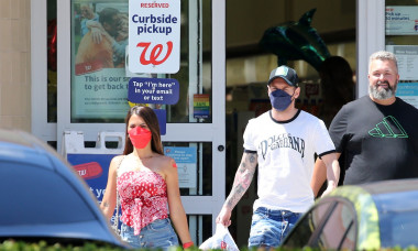 EXCLUSIVE: Argentine football star Lionel Messi and wife Antonella head to a Walgreens pharmacy, presumably to ged a Covid-19 vaccine, and he and his family members later emerged with their red band-aids proudly displayed
