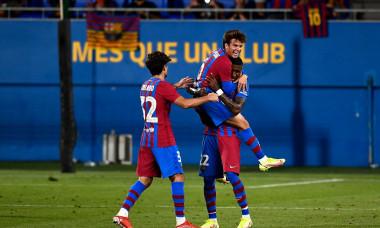 Riqui Puig (C) of FC Barcelona celebrates with his teammates