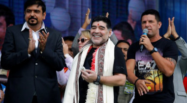 Argentina's soccer legend Diego Maradona smiles as he attends a charity event for cancer-affected patients in Kolkata