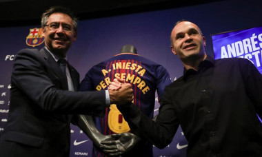 FC Barcelona captain Andres Iniesta shakes hands with FC Barcelona's President Josep Maria Bartomeu after announcing the agreement of a contract for life with FC Barcelona, in Barcelona