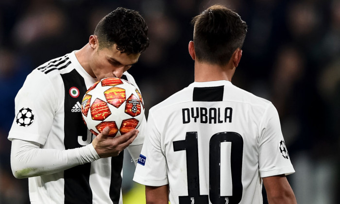 Cristiano Ronaldo (L) of Juventus FC kisses the ball during