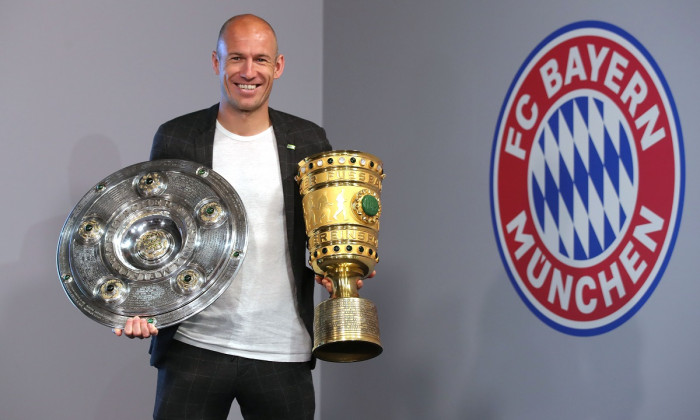 Arjen Robben And Franck Ribery Hand Over Championship And DFB Cup Trophy To FCB Erlebniswelt