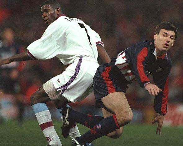 Ian Taylor of Aston Villa and Daniel Prodan of Atletico Madrid