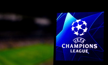 In this photo illustration a UEFA Champions League logo seen displayed on a smartphone.