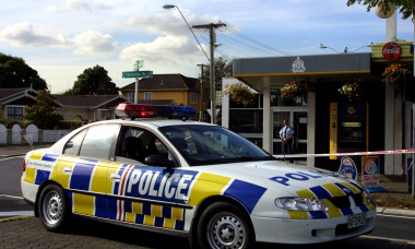 A policeman guards the outside of the ASB bank, th