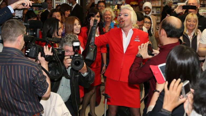 stewardess-richard-branson-serves-passengers-20130511-174232-152