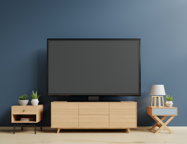 Smart TV on the blue wall in living room