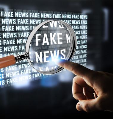 Businessman,On,Blurred,Background,Discovering,Fake,News,Information,3d,Rendering