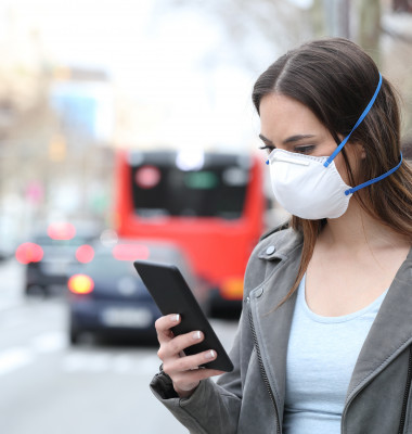 Woman,With,Protective,Mask,Avoiding,Pollution,Using,Smart,Phone,With
