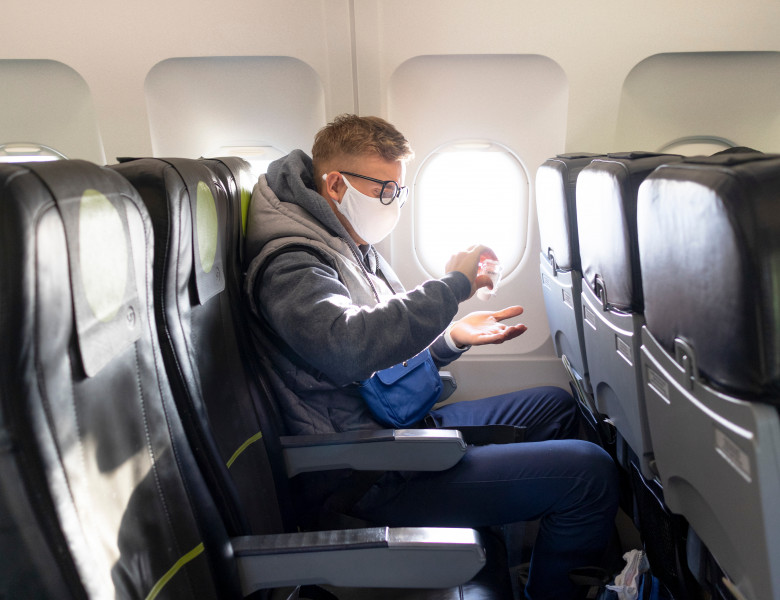 Guy,In,Airplane,,Young,Man,In,Glasses,,Medical,Protective,Sterile