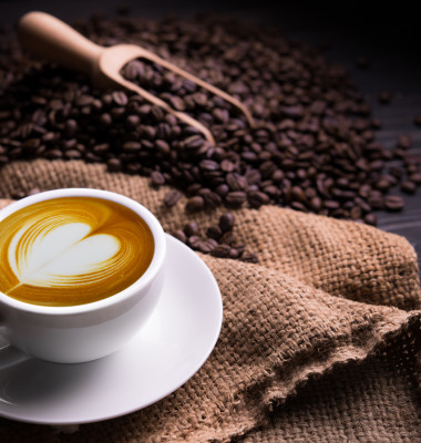 Cup,Of,Coffee,Latte,With,Heart,Shape,And,Coffee,Beans
